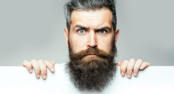 Man with large beard looking quizical