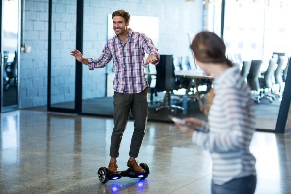 Man using a hoverboard in the office