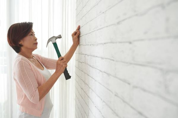 Older woman doing home improvements
