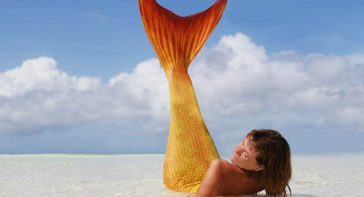 Mermaid lying on a beach