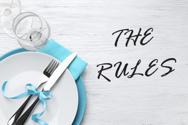 "Table setting with ""the rules"" written beside"
