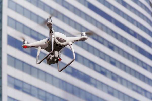 Drone in front of high-rise flats