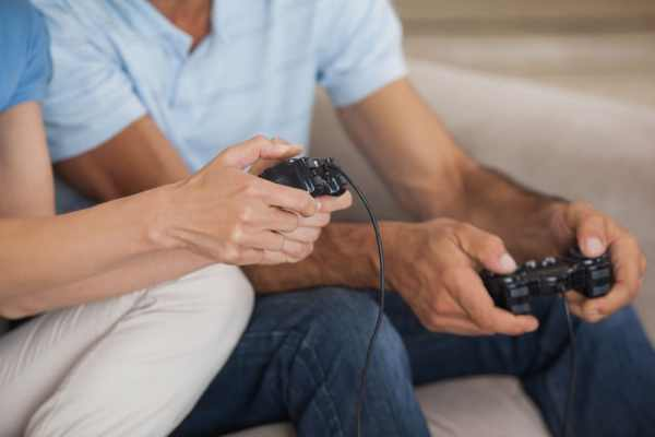 Hands holding video game controllers