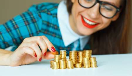 Woman stacking gold coins