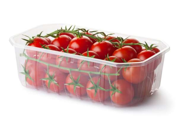 Cherry tomatoes in plastic tub