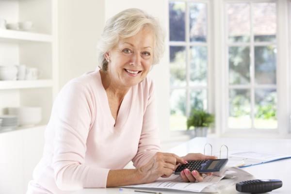 Senior woman calculating her finances