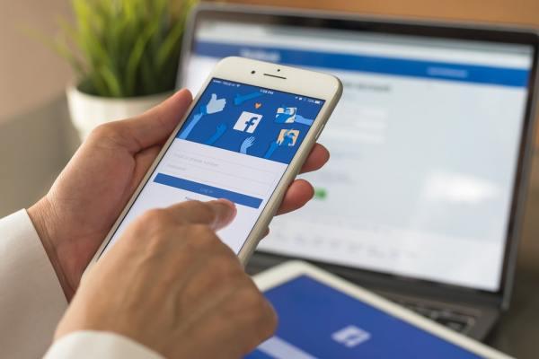 Man using Facebook app on smartphone