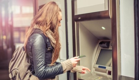 Student withdrawing cash from an ATM
