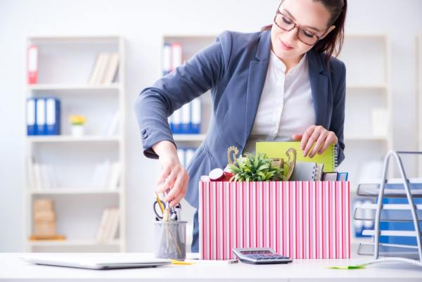 Woman packing up her job after resigning