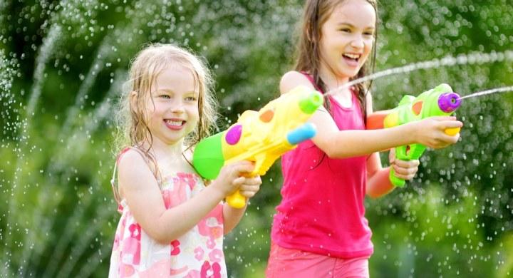 Little girls with water guns