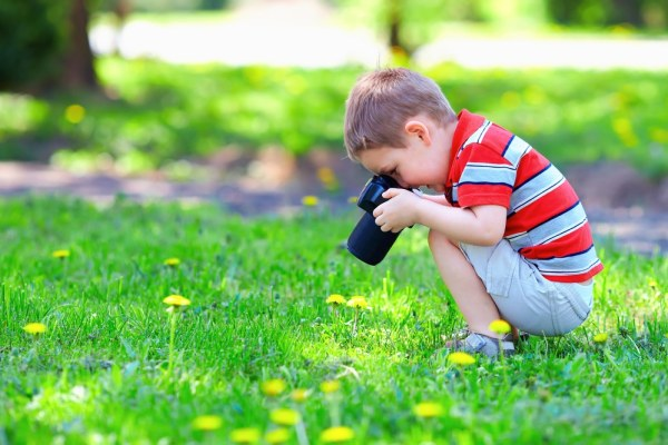 Little boy taking photos of nature