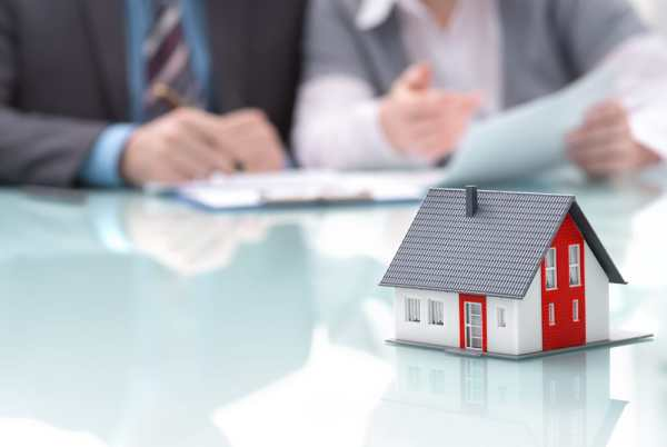 People having a property investment meeting