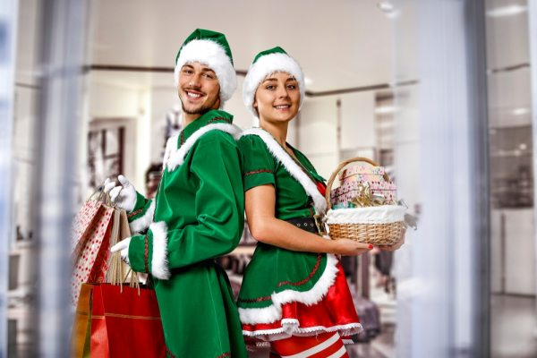 Adults in Christmas elf costumes