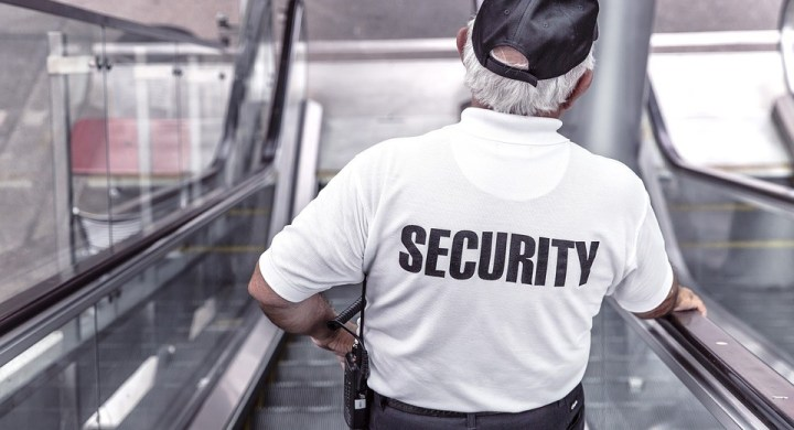 Security officer on escalator
