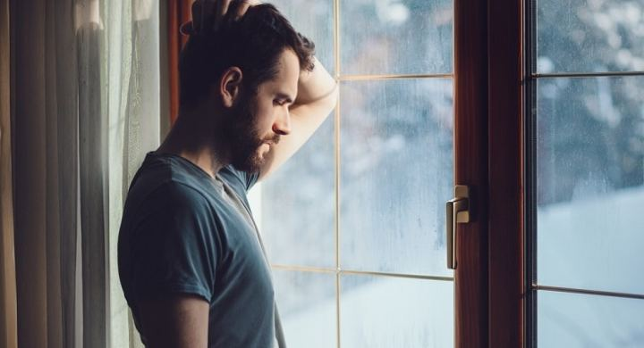 anxious man looking out of the window