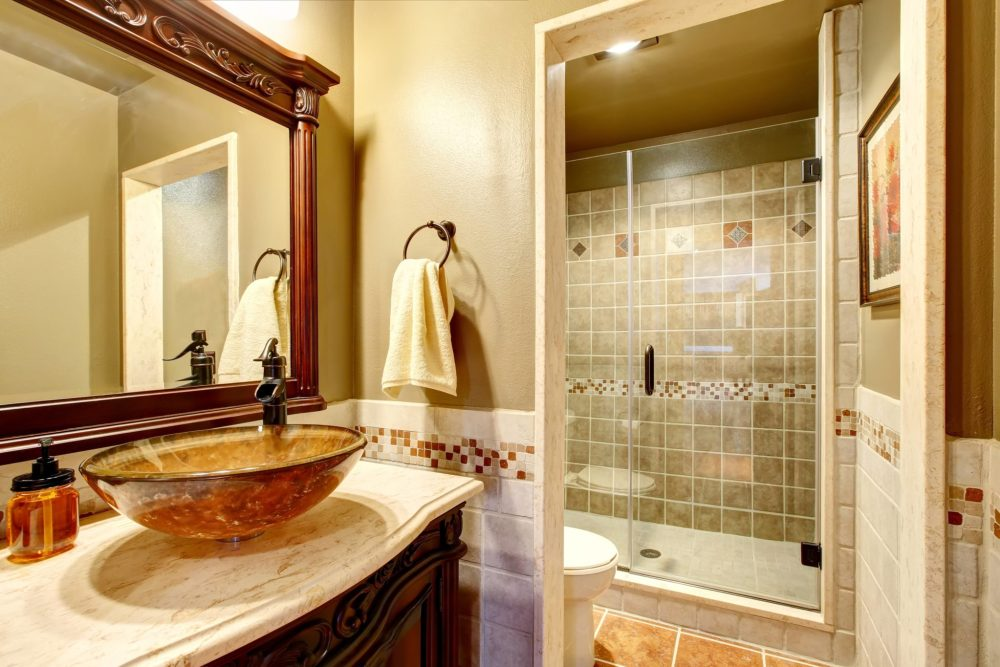 vanity, Bathroom interior in luxury house. Rich bathroom vanity cabinet with vessel sink and mirror. View of shower. Northwest, USA