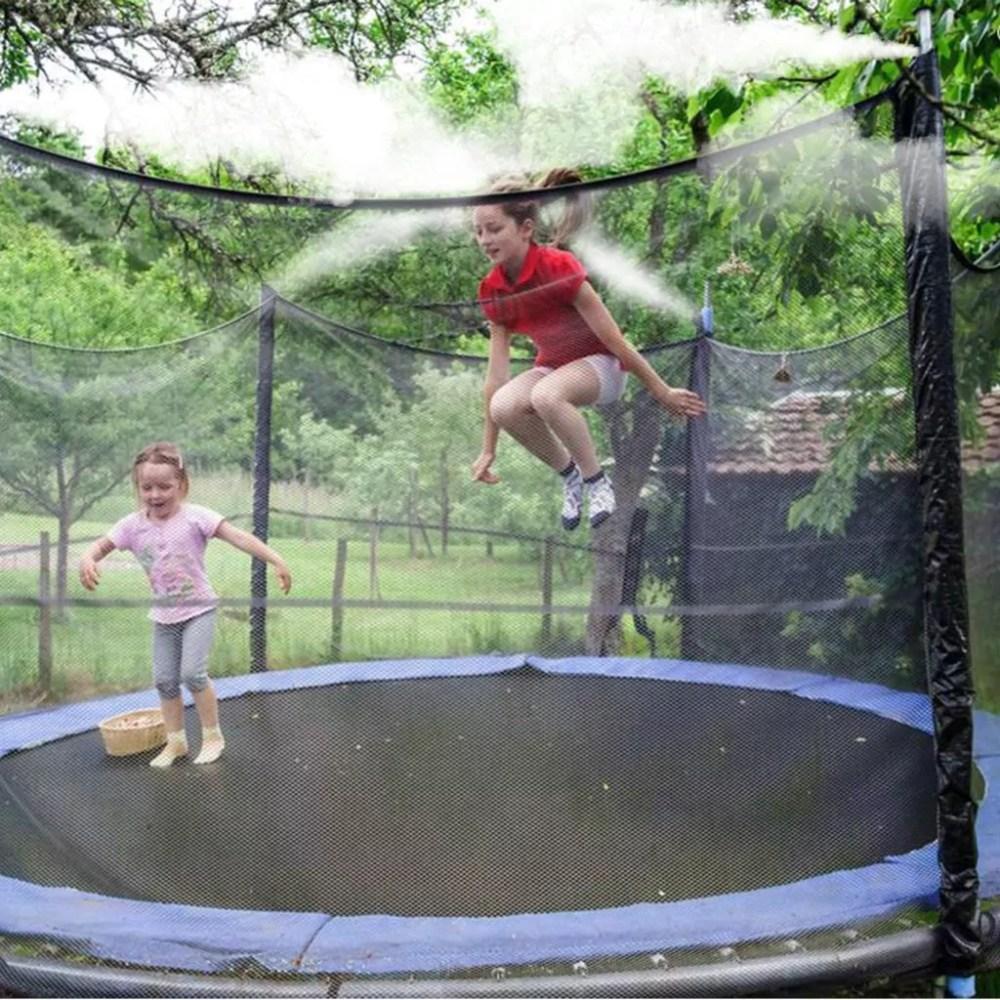 Kids on trampoline with misting sprays