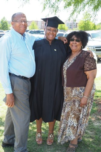 My dad, me and my mom at my graduation in Starkville.