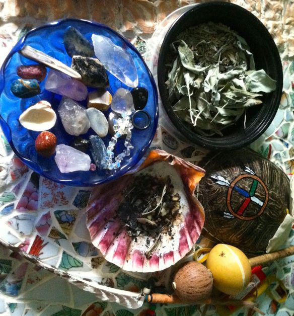 Some of my supplies: Stones and shells, Sage, Rattle, Feather.