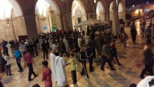Palestinian-youth-gather-at-aqsa-after-Israeli-forces-clash-during-ramadan-2016-1