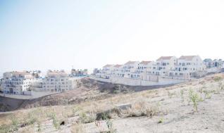 Asentamientos israelíes en tierras palestinas en Jerusalén, el 29 de diciembre de 2016. La construcción de asentamientos israelíes continúan en Ramat Shlomo, un establecimiento judío situado en el este de Jerusalén. Sin embargo, el Consejo de Seguridad de la ONU adoptó una resolución con 14 votos pidiendo a Israel que detenga la construcción de asentamientos y la expansión en los territorios palestinos, Israel anunció la construcción de 5.600 nuevas casas en los territorios palestinos. (Daniel Bar On - Agencia Anadolu)