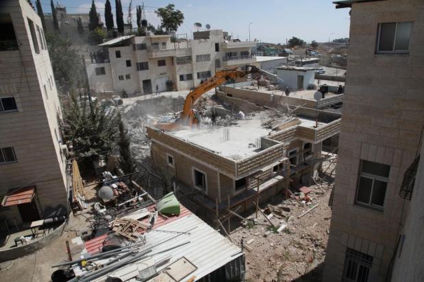 Fuerzas israelíes destruyen una edificación palestina en Jerusalén Este, el 15 de agosto de 2018 (Mostafa Alkharouf – Anadolu Agency )