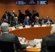 El presidente de Turquía, Recep Tayyip Erdogan, y el ministro de Asuntos Exteriores de Turquía, Mevlut Cavusoglu, asistieron a la Conferencia de Berlín sobre la paz libia en Berlín, Alemania, el 19 de enero de 2020. [Presidencia turca / Murat Cetinmuhurdar / Agencia Anadolu]