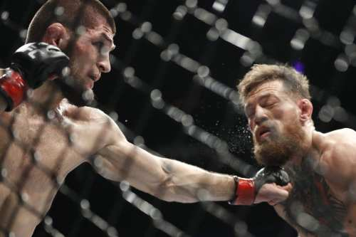 Khabib Nurmagomedov, left, punches Conor McGregor during a lightweight title mixed martial arts bout at UFC 229 in Las Vegas. Photo: AP Photo