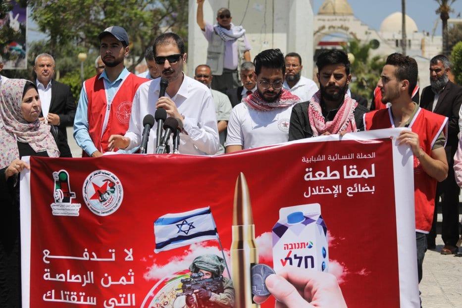Palestinos protestam por boicote a bens israelenses em Gaza [Mohammed Asad/Monitor do Oriente Médio]