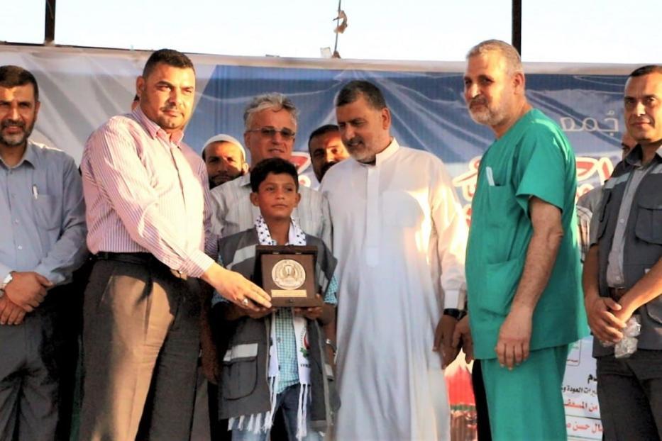 """Ezzeddin Samsoum, 13, foi reconhecido como um """"herói infantil"""" por sua bravura durante a Grande Marcha do Retorno, quando resgatou um homem ferido."""