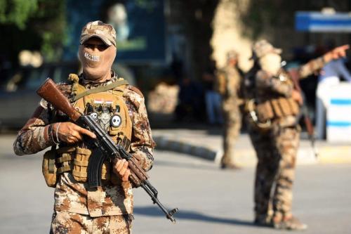 Membros das Forças de Mobilização Popular (PMF) na capital iraquiana, Bagdá, em 26 de outubro de 2019. [Ahmad Al-Rubaye/AFP/Getty Images]