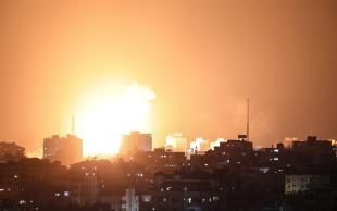 GAZA CITY, GAZA - MAY 10: Fire billow from Israeli air strikes in Gaza City, Gaza on May 10, 2021. ( Mustafa Hassona - Anadolu Agency )
