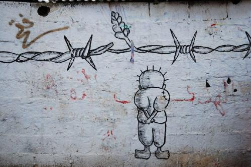 Handala, personagem símbolo da luta palestina, em grafitte reproduzido em redes sociais [Pinterest]