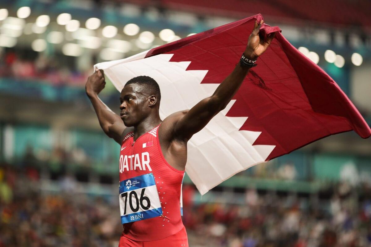Abdalelah Haroun, celebra sua vitória na modalidade de 400 metros rasos de atletismo, no oitavo dia dos Jogos Asiáticos em Jacarta, Indonésia, 26 de agosto de 2018 [Lintao Zhang/Getty Images]