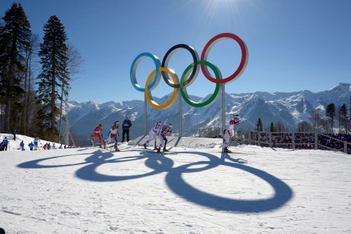 Krasnaya Polyana, RUSSIA; Marit Bjoergen (NOR) (02) passes the Olympic rings as she leads Therese Johaug (NOR) and Charlotte Kalla (SWE) in the ladies skiathon during the Sochi 2014 Olympic Winter Games at Laura Cross-Country Ski and Biathlon Center. Mandatory Credit: Paul Bussi-USA TODAY Sports