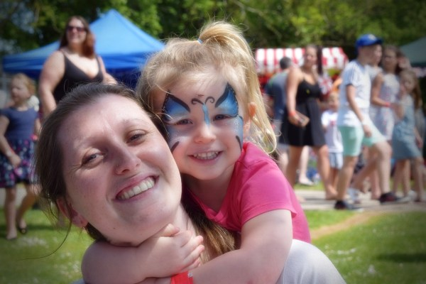 Party in the Park face painted child and parent