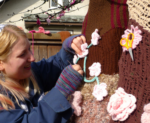 Me yarnbombing with my fingerless gloves on. Photo by Jason Vanderhill