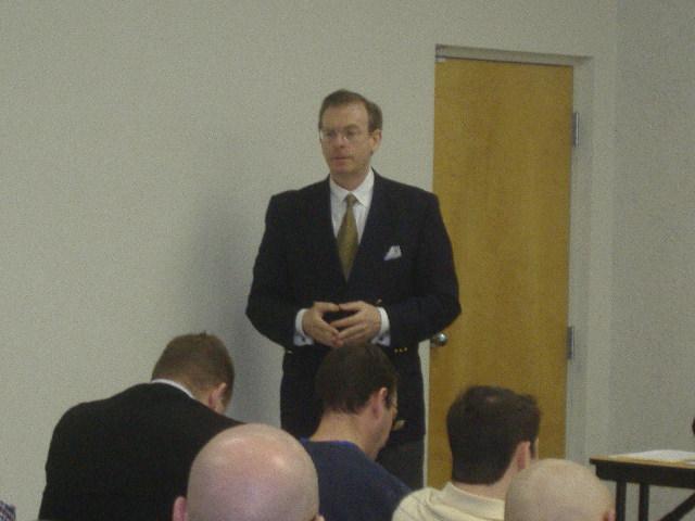 Joe Arminio doing a seminar on his economic and world views.