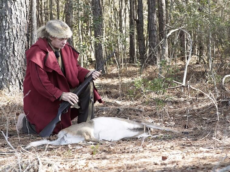 Colbert with a deer as he prepares for the onset of winter when food will be scarce