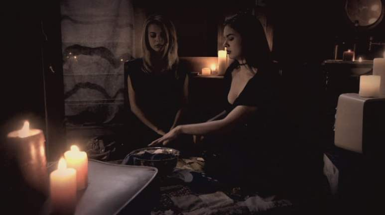 Alyssa and her friend perform a spell aimed at Lee