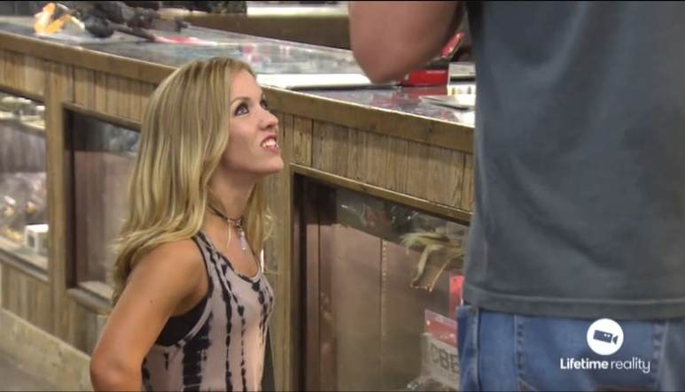 A bewildered Amanda stares up at her blind date Michael on Little Women: Dallas