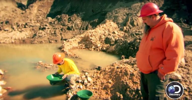 Jim Thurber helps Todd Hoffman look for pockets of gold in the Buckland claim on Gold Rush