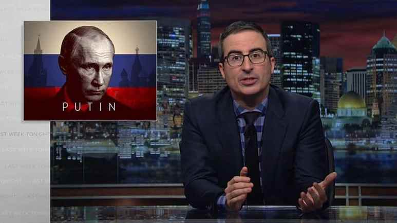John Oliver with a picture of Vladimir Putin behind him
