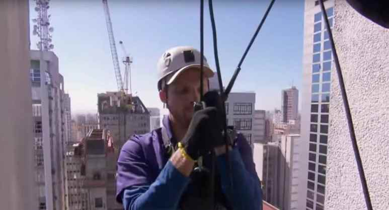 Scott prepares to rappel down the side of the Sao Paolo skyscraper