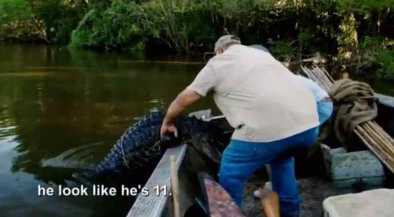 Joey and Dorien haul the gator into their boat