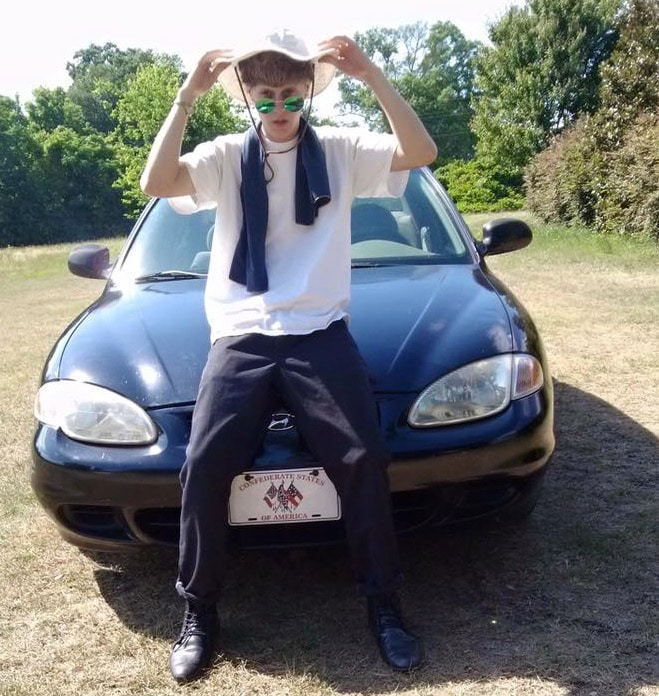 Roof with his car, note the number plate