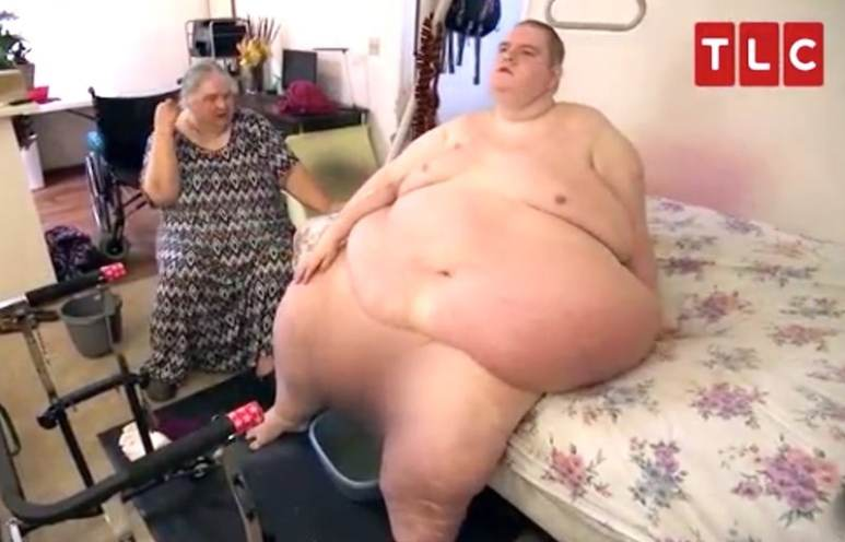 Sean, pictured before he lost weight, with his mother —  who it's feared may be putting brakes on his progress