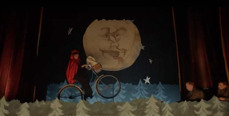 Jennifer Goines on stage recreating the bicycle scene from the film ET: The Extra Terrestrial