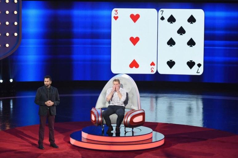 Alex Mullen recalling cards on SuperHuman as host Kal Penn stands beside him