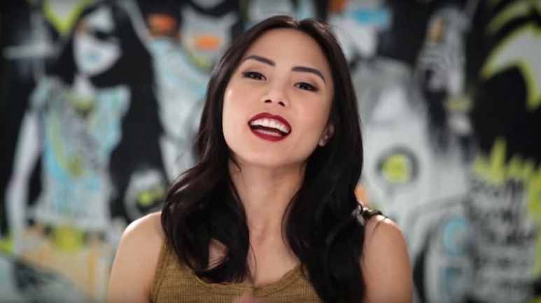 Anna Akana speaking to the camera in a YouTube video